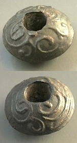 Enlarged photo of celtic spindle whorl